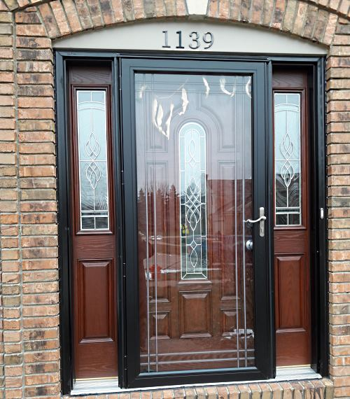 storm door with wood and decorative glass